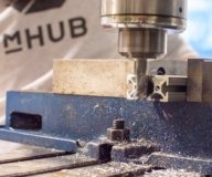 metal pieces get trimmed using drill at mHUB fabrication facility