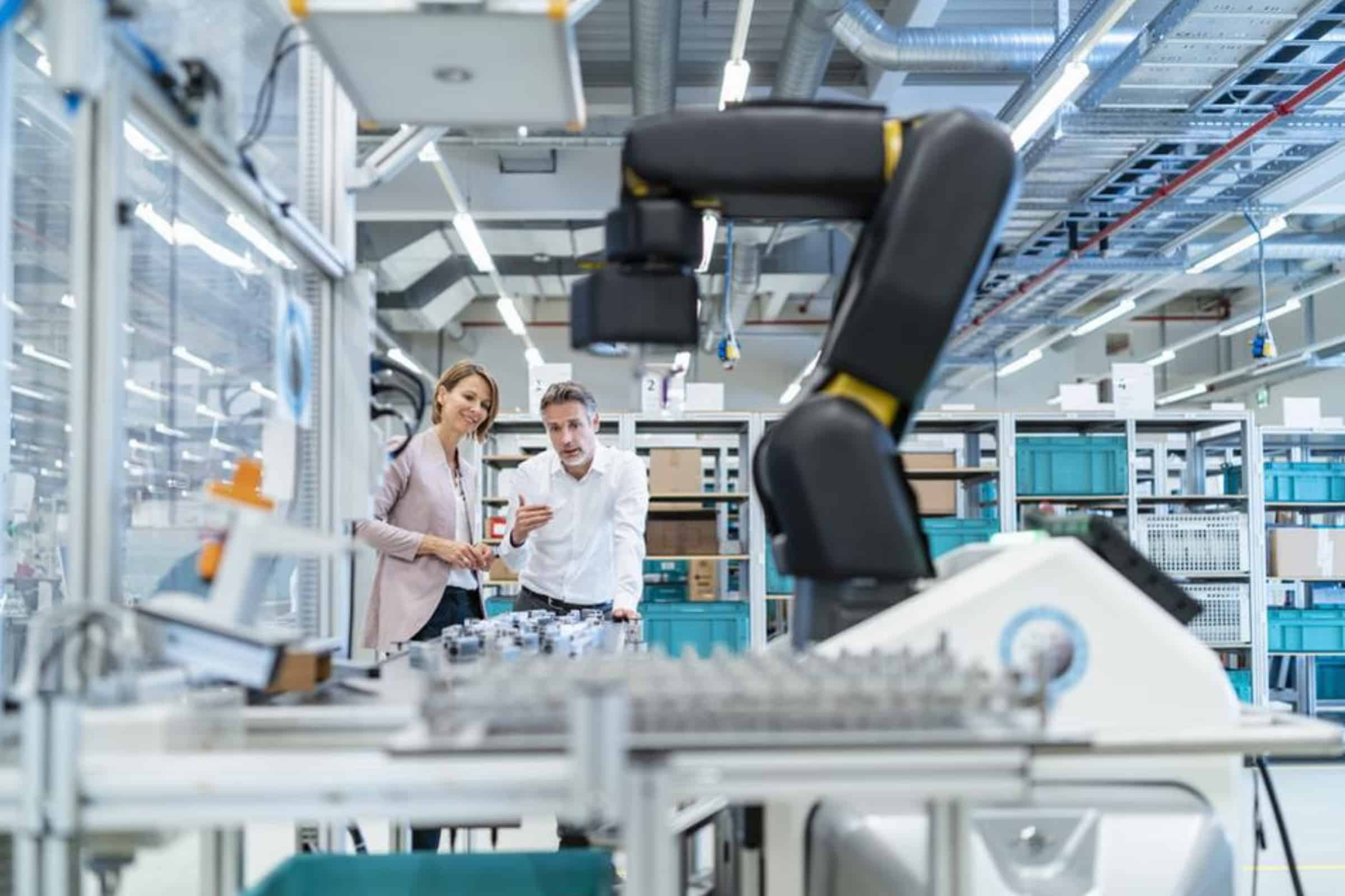 Industry 4.0 Will Help Fuel Economy Post Election (woman and man in a manufacturing facility)