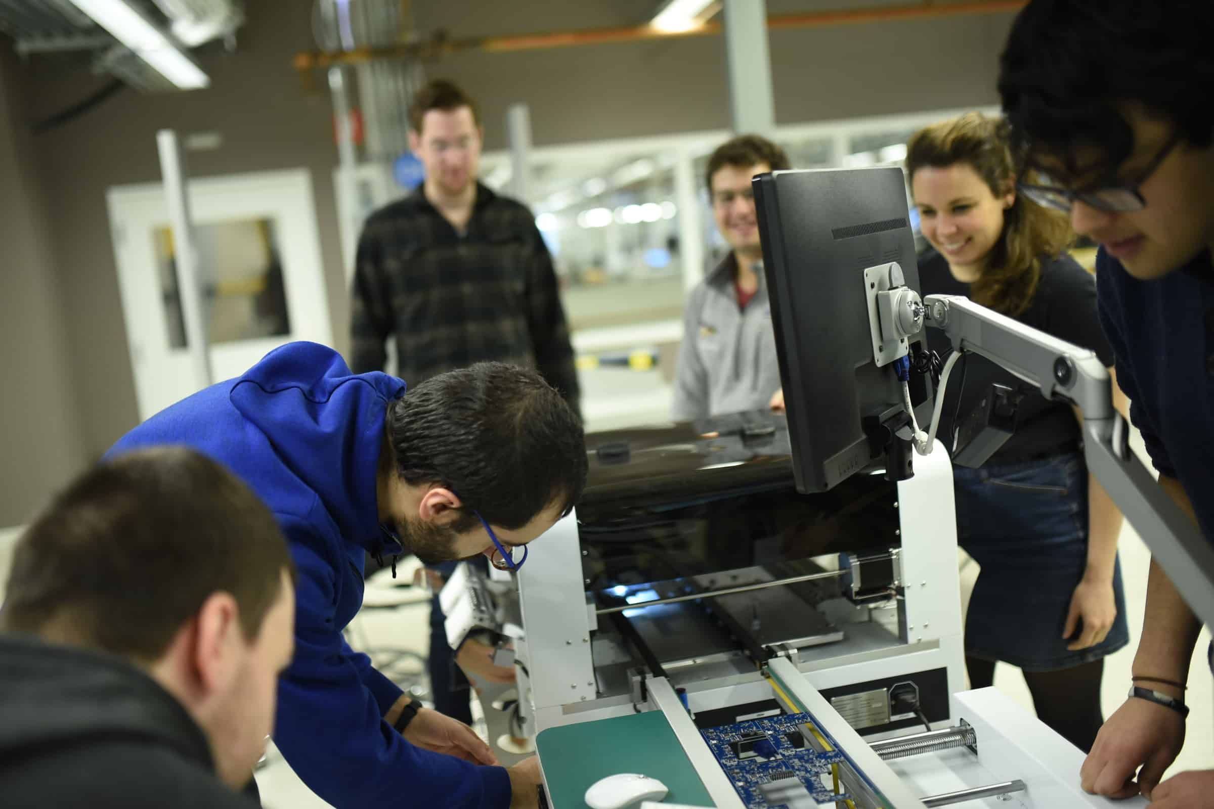 a startup team works on creating circuit boards at mHUB in Chicago